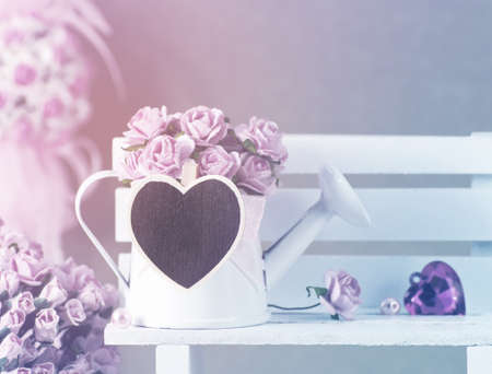 clothes pin: Paper rose flowers in the watering can with blank wooden heart clothes pin