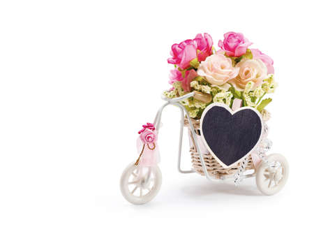 clothes pin: Rose flowers in bicycle basket with heart clothes pin on white background