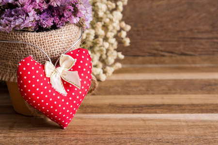 mate married: Heart fabric and dry flowers on wooden background