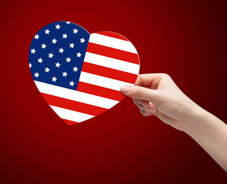 old flag: Hand holding USA flag heart