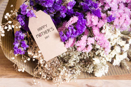 aniversary: Bouquet of dried flowers with mothers day card on the wooden table