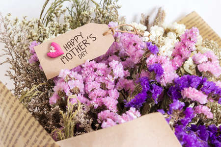aniversary: Bouquet of dried flowers with mothers day card Stock Photo