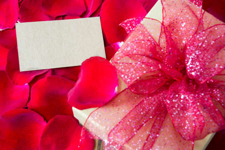 8 years birthday: Blank tag with gift box on red rose petals background