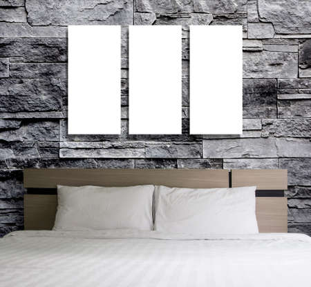 bedroom wall: Blank frame on stone wall in the bedroom