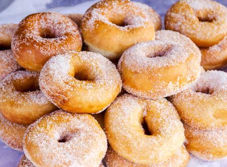 palatable: Close up sugar donuts