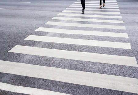 People are walking on the zebra crossing