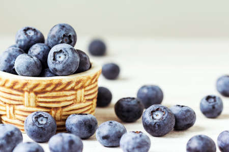 ericaceae: Fresh blueberries on the wooden table Stock Photo