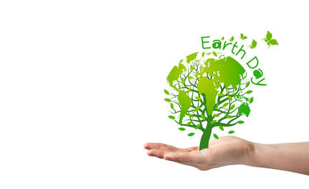 Earth day concept of tree with earth in hand on white background
