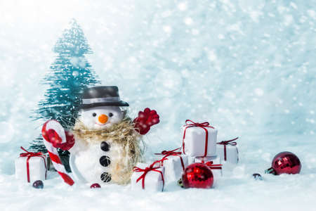 Snowman in the pine forest with snow