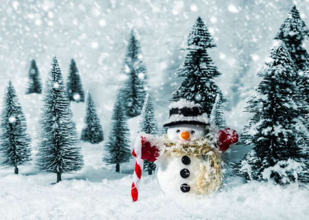Snowman in pine woods during winter