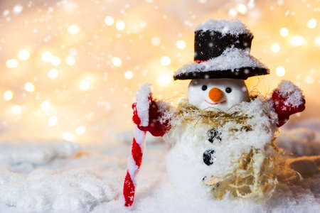 Happy snowman standing in winter with copyspace Stock Photo
