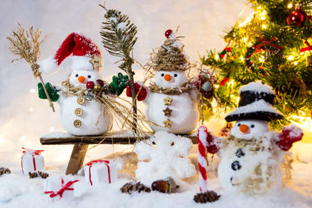Happy family snowman standing in winter with copyspace Stock Photo