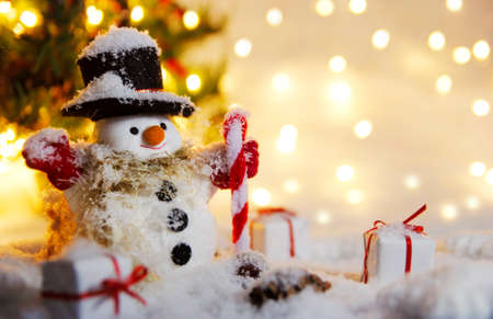 Happy snowman standing in winter with bokeh light Stock Photo