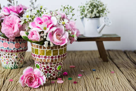 Pink carnation in mosaic flower pot