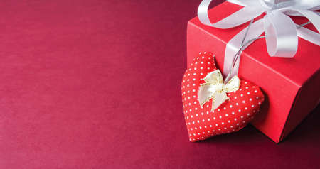 sewing box: Red fabric heart and gift box on paper background