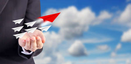 Leadership concept of business woman hand and paper planes with blue sky