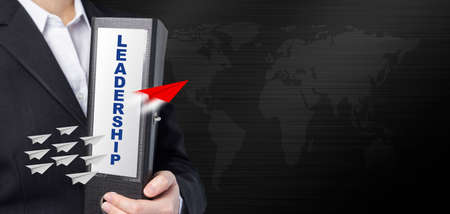 Leadership concept of business woman holding document file with paper planes