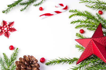 Christmas decoration of red star and snowflake and leaves pine on white background with copy space