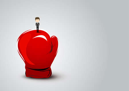 Business concept of businessman standing on red boxing glove.