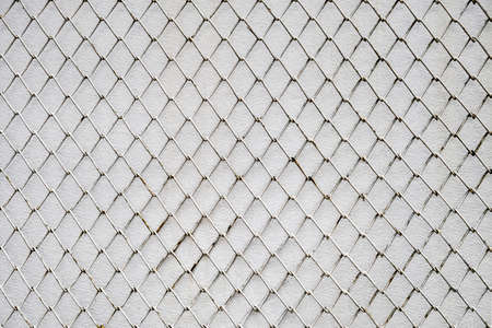 Chain Link fence on white cement wall background