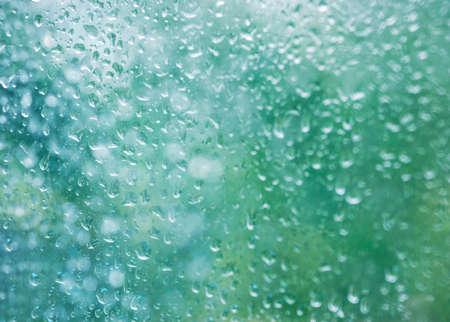 Raindrops on glass window texture background rain season