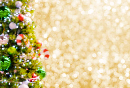Abstract blurred christmas tree on gold bokeh background Reklamní fotografie