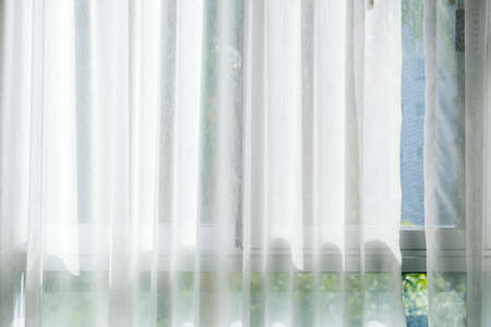 White curtain at the window with sunlight