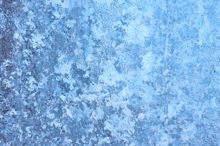 Frosted icy window blue background. Winter texture with a dome for writing or drawing
