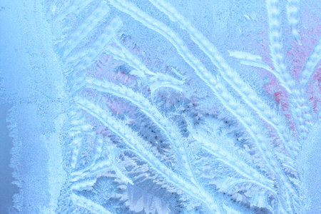 Icy patterns on glass. Winter background with frosty texture