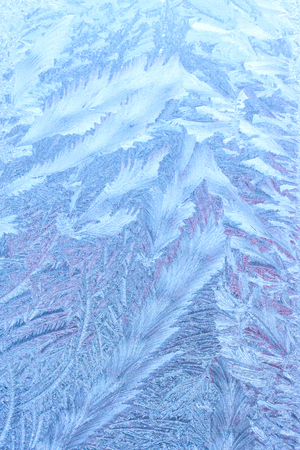 Natural winter frozen abstract background with ice texture