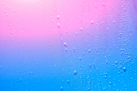 Wet window with condensation on the glass. Natural background with high humidity Stock Photo