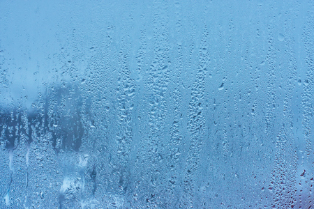 Natural background with condensation on the windows , high humidity , hot water vapor
