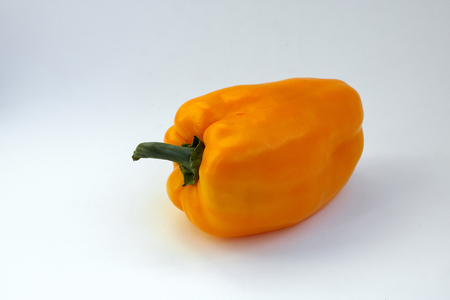 Pepper bell fresh and sweet orange colored on isolated white background. Vegetables agricultural products