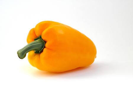 Fresh and sweet pepper bell on isolated white background. Vegetables agricultural products. Orange colored