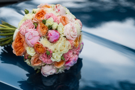 Wedding beautiful bridal bouquet of natural flowers, closeup with blurred background