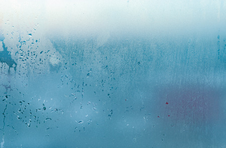 Water drops from home condensation on a window. Misted glass background. Strong humidity in wintertime Banco de Imagens