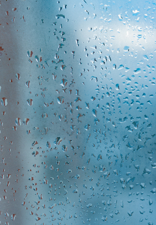 Water drops from home condensation on a window. Misted glass background. Strong humidity in wintertime Stock Photo
