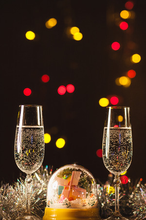 New Year's at midnight with champagne glasses on blurred background
