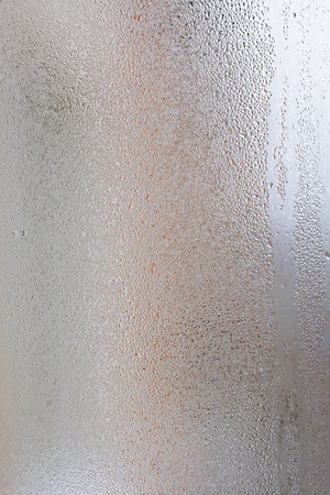 Background of the condensate flowing water on the window glass Stock Photo