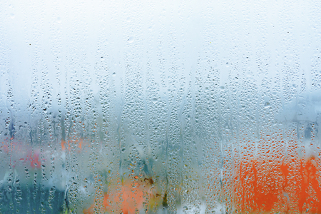 Natural water drop background, window glass with condensation humidity, large droplets flow down. Collecting and streaming down Stock Photo