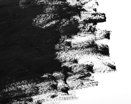 Black brush strokes on white paper. Dark abstract watercolor paint texture