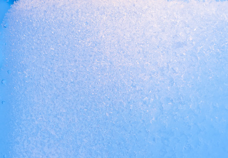 Background of frozen window glass, very strong frost and cold, texture in blue color, copy space