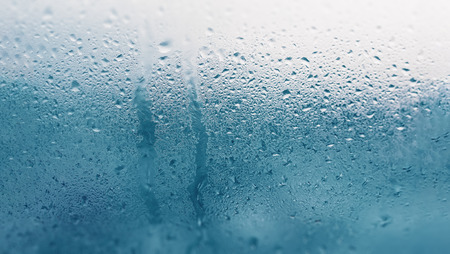 Detail of moisture condensation problems, hot water vapor condensed on the cold glass close up Stok Fotoğraf