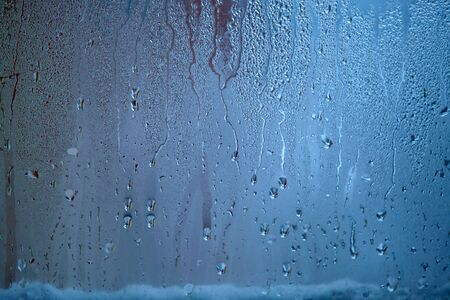 Drops of condensed steam, water drops. Close up detail of moisture condensation problems. Hot water vapor condensed on the cold window glass Stockfoto