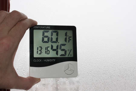 Thermometer and hygrometer of electronic to control temperature and humidity. Humidity indicator is indicated on the hygrometer of the device 版權商用圖片