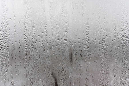 Dripping Condensation, Water Drops Background Rain drop Condensation Texture. Close up for misted glass with droplets of water draining down Imagens