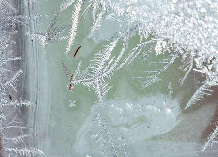 Beautiful natural background or texture of frozen transparent glass on the window in winter, strong cold concept, horizontal image, copy space for your design or text