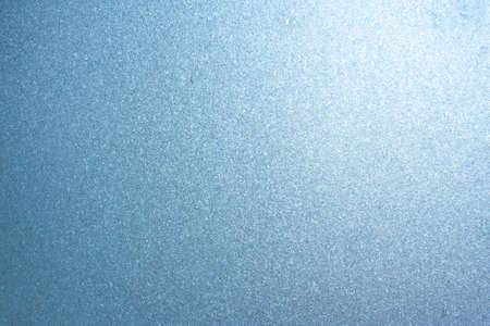 Completely frozen window on transparent glass. Clean background. Extreme low temperatures in winter. Water vapor condenses on cold window glass and freezes