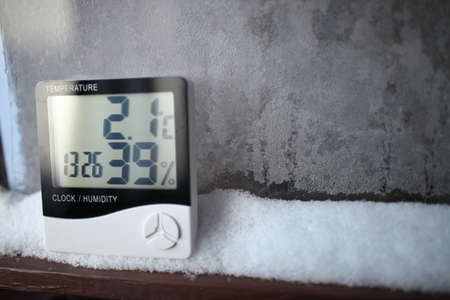 An electronic thermometer and hygrometer for temperature and humidity control is installed on the snow. The humidity indicator is indicated on the hygrometer of the device