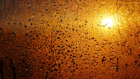 Natural background of condensation, drops of flowing water on the window pane Фото со стока